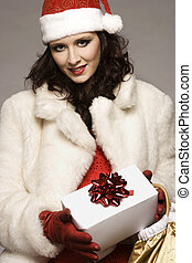 santa girl - beautiful brunette girl wearing Santa costume...