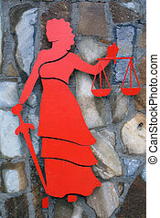 Justice - Siombol of justice on thestone wall in Turkey...