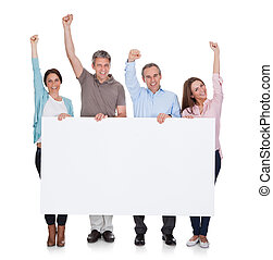 Group Of Happy People Holding Placard Over White Background
