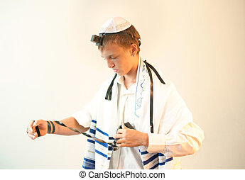 Religious Jewish teenager - Young Jewish man does  prayers .