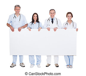 Group Of Doctor Holding Placard - Group Of Happy Doctor...
