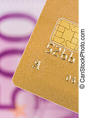 golden credit card and calculator - a gold credit card for...