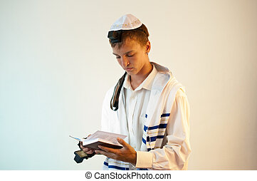 Young Jewish man does prayers . - Religious Jewish teenager...