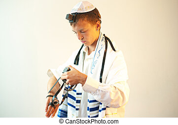 Young Jewish man does prayers - Religious Jewish teenager...