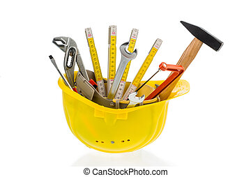 tool in a protective helmet - different tools of a craftsman...