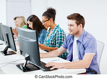 student with computer studying at school - education concept...