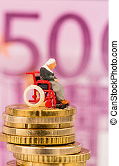 woman in wheelchair on money stack. before euro note