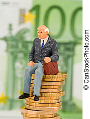 pensioners sitting on a pile of money - a pensioner sitting...
