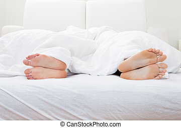 Close-up, couple's, feet, sleeping, bed