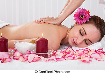 Woman getting spa treatment - Beautiful young woman getting...