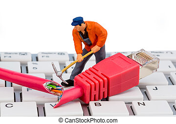 workers, network connector, keyboard - a worker repairs a...
