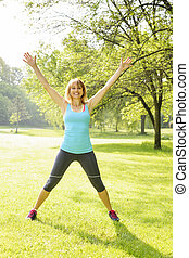 Smiling woman exercising outside
