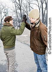 Two men doing high five in park - Two young men meeting in...