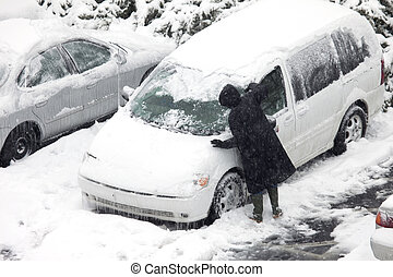 scraping snow and ice - A person scraping snow and ice...