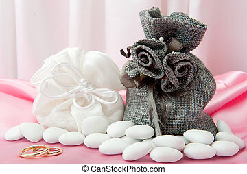 wedding rings and favors on elegant fabric - wedding rings...