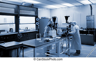 Biotechnology lab - two scientists in chemical environment...