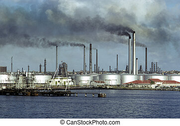 Oil refinery - oil refinery on gulf, spewing fumes and gases