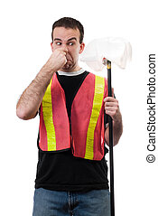 Smelly Garbage - Worker holding his nose because of the...