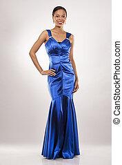 black woman in evening gown - beautiful woman wearing blue...