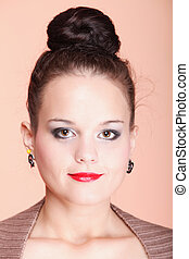 young beautiful girl fancy make-up and hair bun - Portrait...