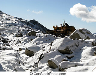 bulldozer clearing snow - A bulldozer vehicle clearing Snow...