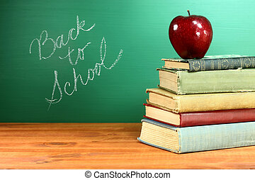 Back to School Books and Apple With Chalkboard - Copy Space...