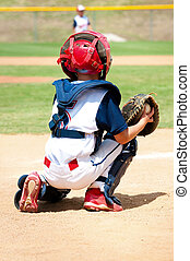 Young baseball catcher during game. - Youth baseball boy...