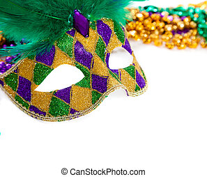 Marid Gras Mask and beads on white - A purple, gold and...