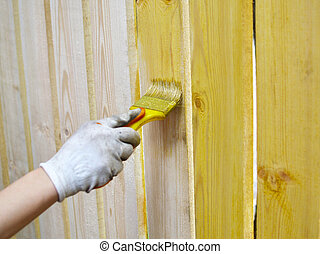 Wooden fence - Painting wooden fence with yellow paint