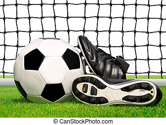 soccer ball and shoes in grass - soccer ball and shoes and...