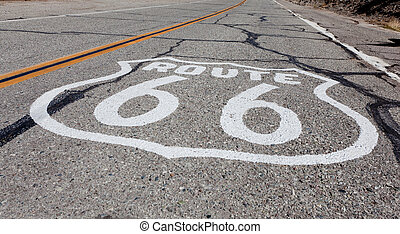 Route 66 highway shield painted on a old highway in California