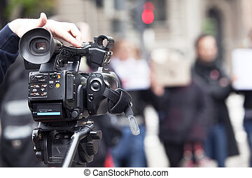 video camera - Covering a street protest using video camera