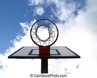 Scoring - Basketball hoop under blue sky with clouds