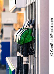 Pump nozzles at the gas station.