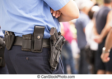 police officer - Policeman with handgun on his holster