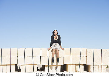 Confident mature woman outdoor wall