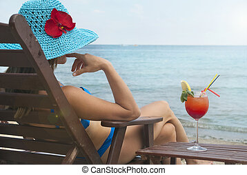 Woman and cocktail - Woman with cocktail on a tropical beach