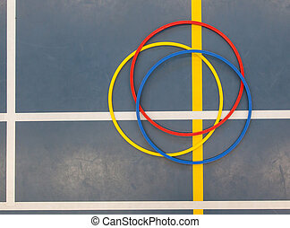 Hula-hoops on a blue school gym floor