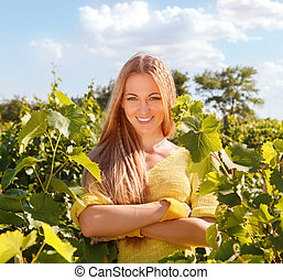 Woman winegrower at harvest time in the vineyard