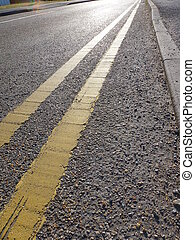Double Yellow Lines - Double yellow lines on road indicating...
