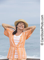 Joyful mature woman ocean beach - Portrait beautiful mature...