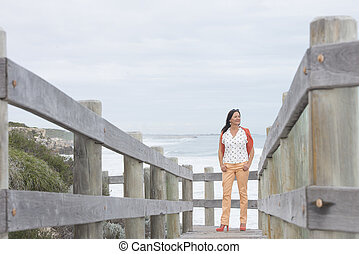 Confident relaxed mature woman beach - Portrait attractive...