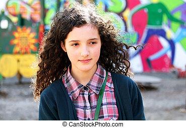 Teenage girl having fun in the playground