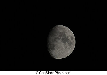 Half moon in the night on a black background