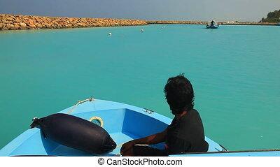 Boat Maldives Turkuise water - Motor boat slides slowly on a...