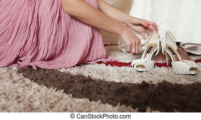 Dress bridal shoes - ridesmaid helps in getting dressed...