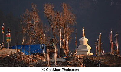 Flags stupa. - Culture and religion in the modern village....