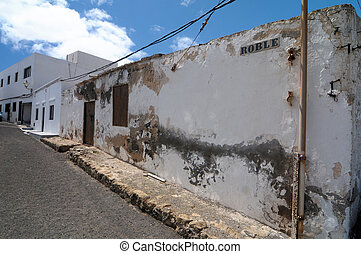 Old aged wall near a street, in Lanzarote, Spain