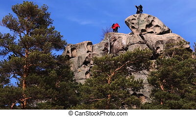 People on the rock top.