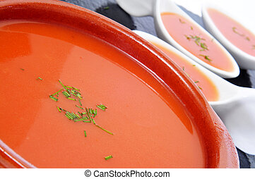 spanish gazpacho - closeup of a earthenware bowl with...